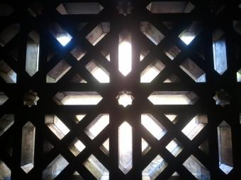 Light coming through the geometric Moorish designs
